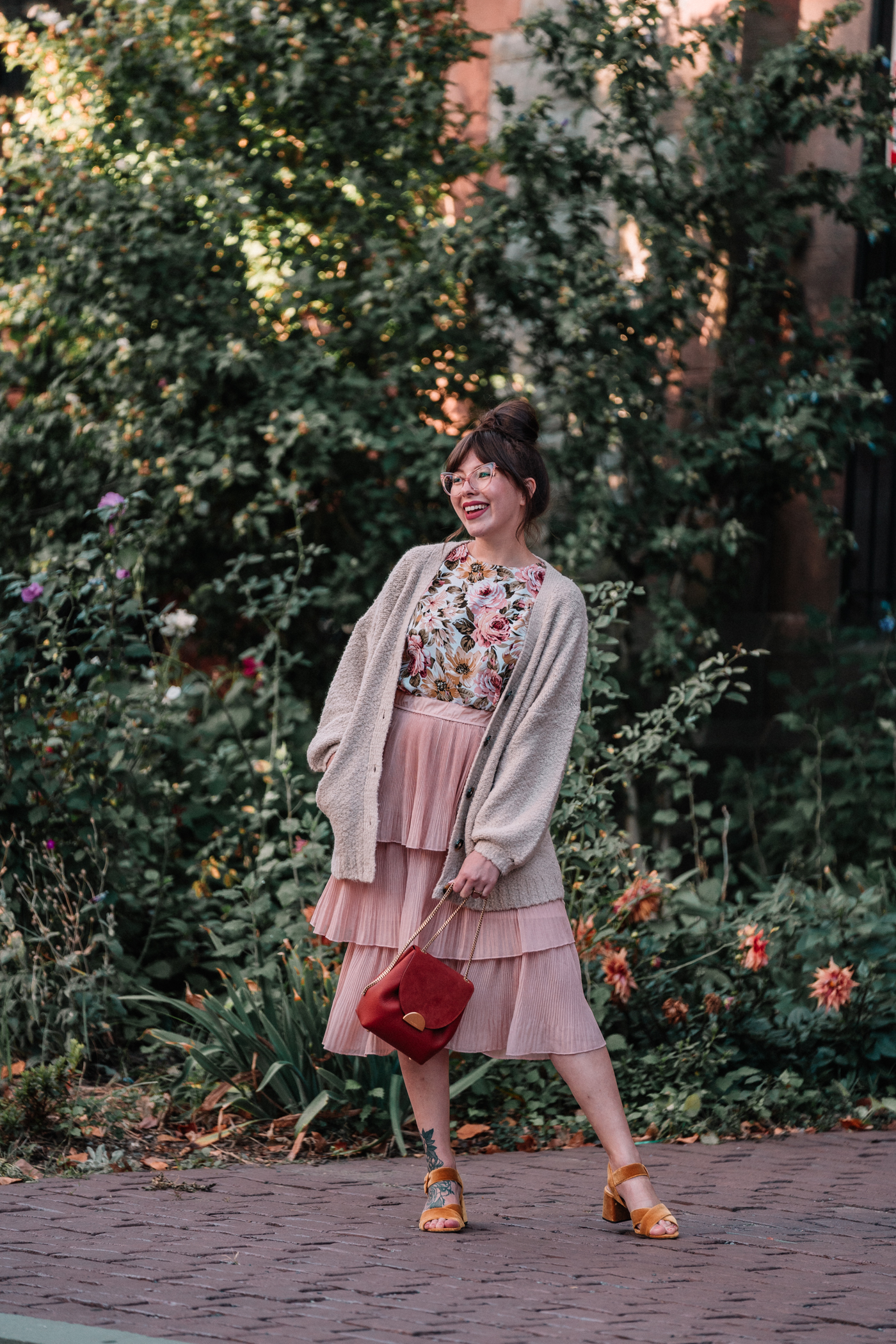floral fall outfit with tiered blush skirt, cozy knit sweater, and velvet heels.